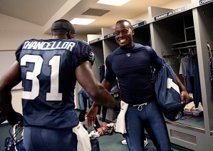 Tarvaris Jackson and Kam Chancellor congratulate each other in the locker room after the victory.