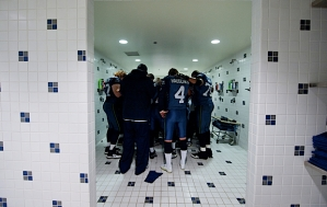 Players gather in the shower for a pregame prayer.