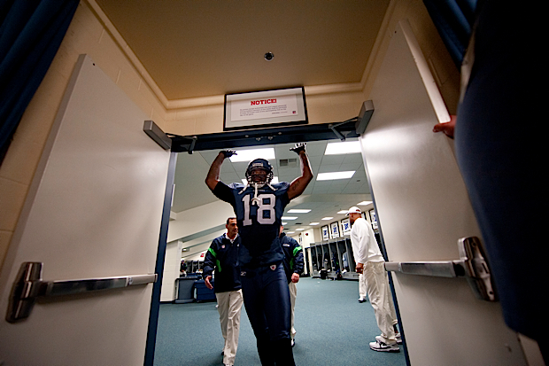 "Wide receiver Sidney Rice ""taps in"" as he leaves the locker room to head to the field for pregame introductions."