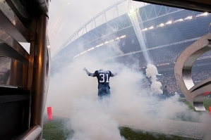 Strong safety Kam Chancellor heads out onto the field amid fog, pyrotechnics and the roar of the 12thMan.
