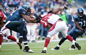 Seattle's Chris Clemons swings Arizona's Todd Heap by the jersey for a tackle.