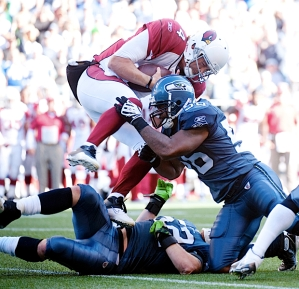 Arizona quarterback Kevin Kolb scrambled, only to be hammered by Seahawks linebacker Leroy Hill.