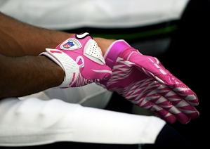 Each team in the NFL selects one home game during October to honor Breast Cancer Awareness Month and so the Seahawks donned their pink gear for the second week in a row. Wide receiver Golden Tate dons his pink gloves before leaving the locker room.