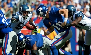 Seattle's defense swarmed Giants quarterback Eli Manning, causing this first quarter fumble, which was caused by Chris Clemons and recovered by Earl Thomas.