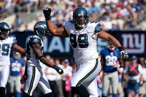Seattle's Alan Branch celebrates after sacking Manning.