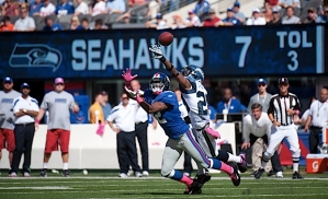 Walter Thurmond replaced the injured Marcus Trufant at cornerback, and knocked away this pass intended for New York's Mario Manningham.