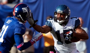 Doug Baldwin serves up a stiff arm to the face of New York's Aaron Ross in the second half.