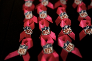In honor of National Breast Cancer Awarenes Month, uniforms were adorned with pink and these ribbons were worn by coaches and staff members on the sidelines