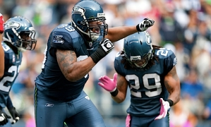 Defensive lineman Alan Branch celebrates with teammates after stopping Michael Turner for a one-yard gain.