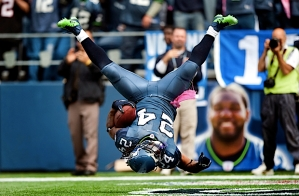 Marshawn Lynch punctuates his 11-yard touchdown run with a flip into the end zone.