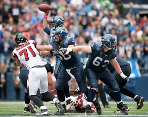 Seattle's young offensive line protected quarterback Tarvaris Jackson all day, allowing no sacks as Jackson had time to pile up 319 yards and three touchdowns.