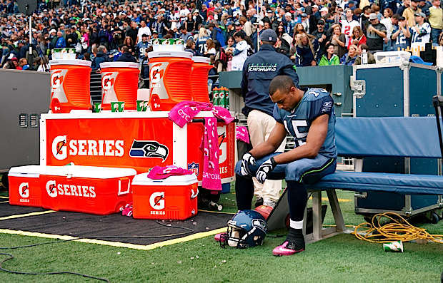 First-year receiver Doug Baldwin sits alone on the bench after the Seahawks furious second half rally fell short, resulting in a 30-28 defeat.