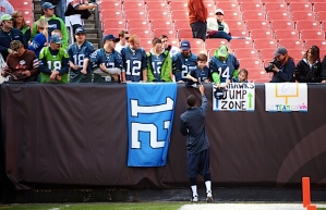 Deon Branch signed autographs for members of the 12th MAN who attended the road game.