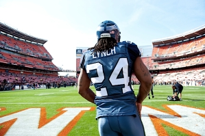 Starting running back Marshawn Lynch took the field for pregame warmups before back issues prevented him from playing.
