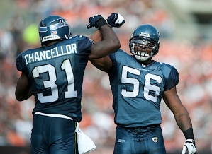 Kam Chancellor and Leroy Hill celebrate a stop on third down during the second quarter.