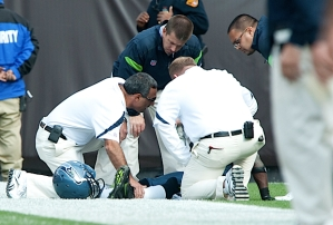 Seahawks medical staff attends to cornerback Walter Thurmond, who suffered a season-ending leg injury.