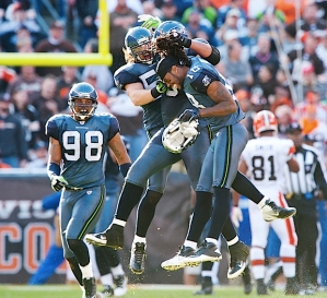 Red Bryant celebrates with teammates Raheem Brock, David Vobora, and Sidney Rice after blocking the field goal.