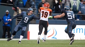 Cincinnati's Brandon Tate splits punter Jon Ryan and linebacker David Vobora on this 56-yard punt return as the Bengals scored 17 fourth quarter points to put the game out of reach.