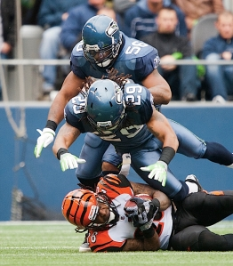 Seattle's defense played well again, with Leroy Hill (56) and Earl Thomas (29) pouncing on Bengals running back Bernard Scott.