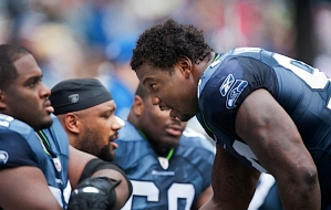 Anthony Hargrove talks strategy with his defensive teammates on the sidelines between drills.