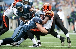 Heath Farwell made his home debut with the Seahawks and showed his special teams prowess with this hard tackle of Bengals returner Brandon Tate.