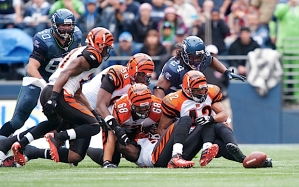 Players from both teams try to find the football after a fumble by Seattle's Marshawn Lynch that was eventually recovered by the Bengals