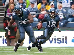 Wide receiver Sidney Rice races upfield after a catch as Russell Okung looks to make a block.