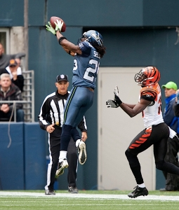 Rookie cornerback Richard Sherman, in his first NFL start, makes an interception on a long pass near the end zone.