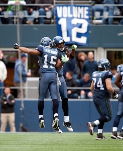 Doug Baldwin celebrates with Sherman after the interception. The two were college teammates at Stanford before entering the NFL this season.