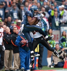 Doug Baldwin caught this pass in traffic along the sideline to keep a drive alive.