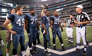 Texas natives Clint Gresham (49) and Russell Okung (76) joined season captains Tarvaris Jackson (7) and Michael Robinson (26) for the coin toss.