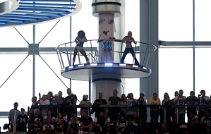Everything's bigger in Texas, they say, and that apparently includes stationing dancers high above the field on elevated stages near the roof of the stadium.