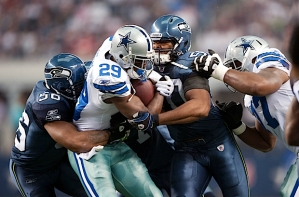 Seattle's defense started tough, with Leroy Hill (56) and K.J Wright (50) combining to stop Dallas running back DeMarco Murray.