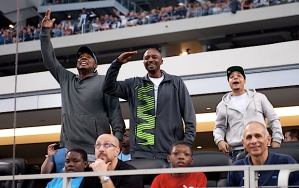 Seattle native and Dallas Mavericks star Jason Terry (center) watched from an end zone suite, and saluted Seahawks defensive tackle Brandon Mebane during a timeout.