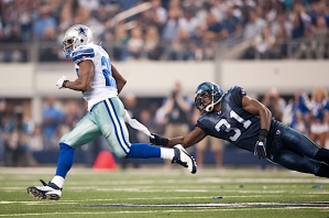 Safety Kam Chancellor dives but could only come up with the towel of Cowboys running back DeMarco Murray on this play.