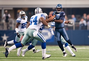 Quarterback Tarvaris Jackson scrambles and is brought down in the fourth quarter.
