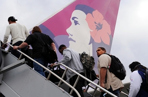 Players boarded the team's Hawaiian Airlines charter under cloudy skies in Seattle.