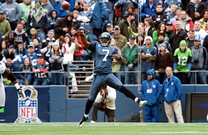 After scrambling out of the pocket, Tarvaris Jackson lets fly after finding Doug Baldwin open downfield.