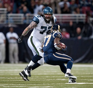 St. Louis defensive back Quintin Mikell intercepted a pass from Tarvaris Jackson but then found himself face-to-face with Seahawks lineman Robert Gallery.