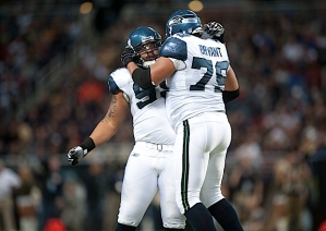 Seattle's big defensive linemen Alan Branch and Red Bryant celebrate after stopping Rams running back Steven Jackson.