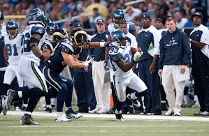 Leon Washington returns a punt 37 yards along the Seahawks sideline.