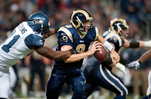 Defensive end Chris Clemons wreaked havoc on the Rams, here creating a sack and fumble by St. Louis quarterback Sam Bradford.