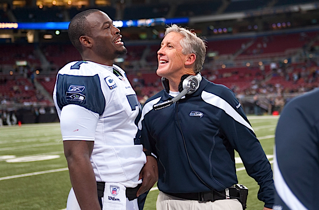 Quarterback Tarvaris Jackson and head coach Pete Carroll share a laugh in the game's waning moments.