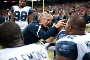Head coach Pete Carroll congratulates Bryant after the interception.