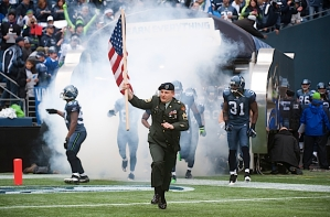 A member of the military carried the American Flag and led the Seahawks out of the tunnel during pregame introductions.