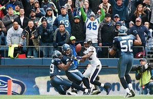 Seahawks defensive backs Brandon Browner and Earl Thomas collide in the end zone and nearly intercept a pass from Flacco.