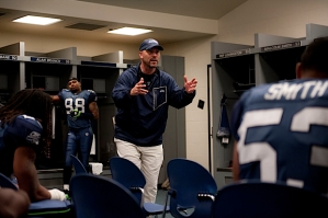 In the locker room at halftime, Gus Bradley gave instructions to his defensive unit.