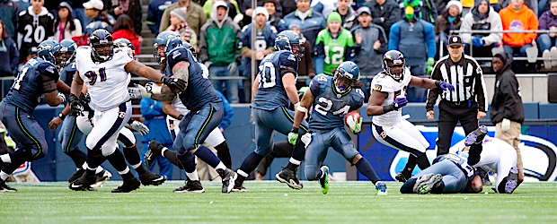 The Seahawks insisted on establishing their ground game, and it paid off. Marshawn Lynch breaks through a hole on his way to some of his 109 rushing yards.