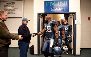 Seahawks owner Paul Allen greets players including Michael Robinson as they returned to the locker room after the victory.