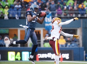 Cornerback Brandon Browner makes a leaping interception in front of Washington's Jabar Gaffney in the second quarter.